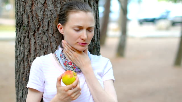 young woman with sore throat eating apple - larynx stock videos & royalty-free footage