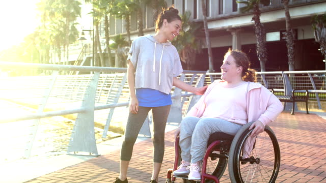 young woman with spina bifida, friend outdoors - persons with disabilities stock videos & royalty-free footage