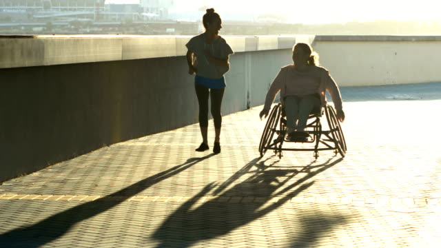 young woman with spina bifida, friend, racing - persons with disabilities stock videos & royalty-free footage