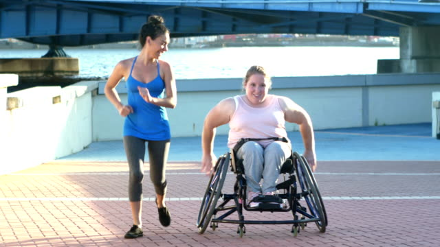 young woman with spina bifida, friend, running uphill - moving toward stock videos & royalty-free footage