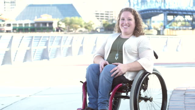 young woman with spina bifida, in wheelchair - three quarter length stock videos & royalty-free footage