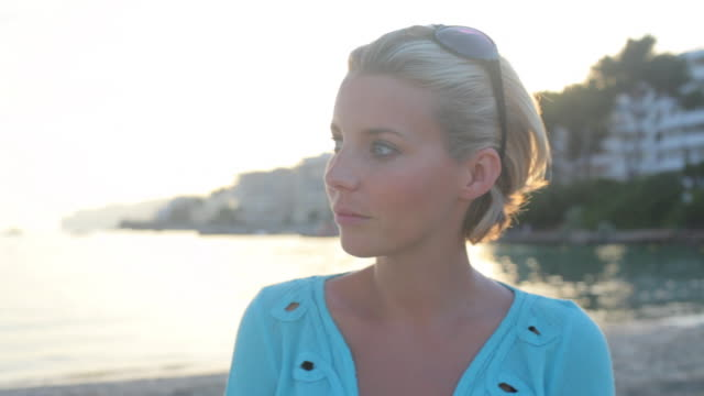 pan cu young woman with sun setting behind her,mallorca - majorca stock videos & royalty-free footage