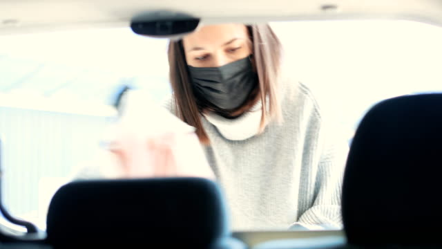 young woman with surgical masks packing groceries from supermarket in car trunk - boot stock videos & royalty-free footage