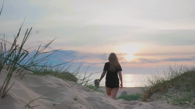 young woman with tattoos on a beach in sweden - sand dune stock videos & royalty-free footage