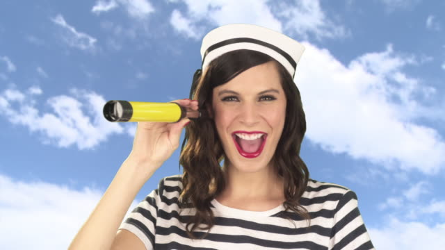 young woman with telescope pointing and smiling - sailor suit stock videos and b-roll footage