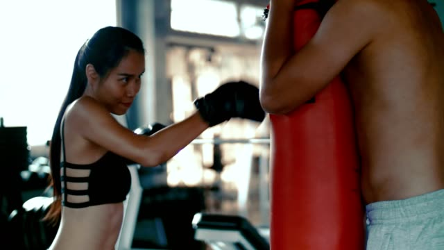young woman with trainer at boxing in the gym - glove fist stock videos & royalty-free footage