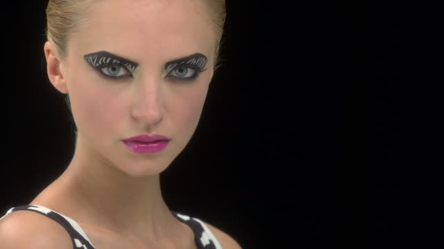 young woman with zebra stripe eye makeup opening eyes and looking at camera - zebra print stock videos & royalty-free footage
