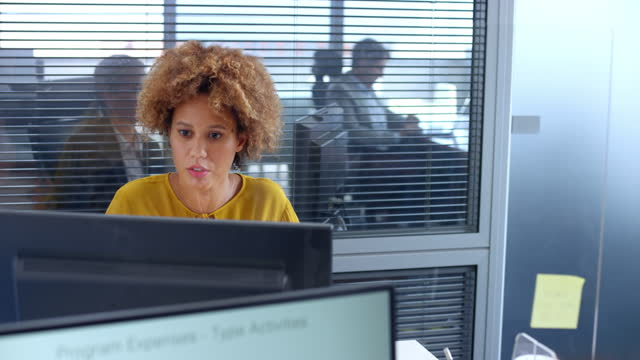 young woman working at her desk in the office - 40 44 years stock videos & royalty-free footage
