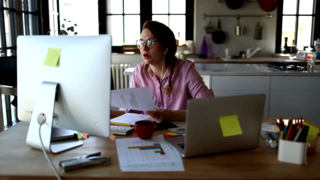 young woman working from home - home interior stock videos & royalty-free footage