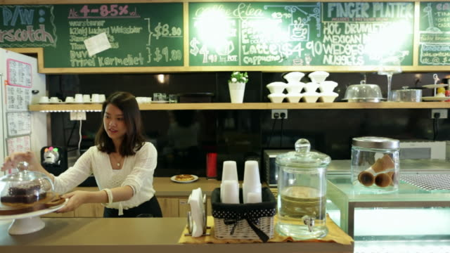 ws young woman working in a cafe. - young women stock videos & royalty-free footage