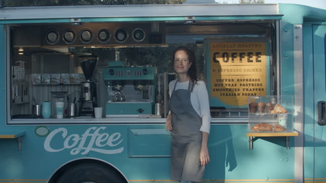 young woman working in a food truck - service stock videos & royalty-free footage