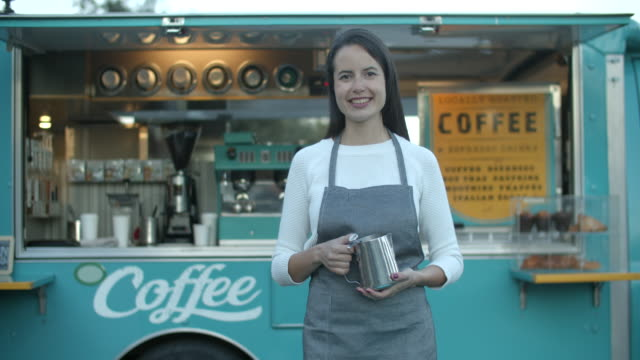 young woman working in a food truck - owner stock videos & royalty-free footage