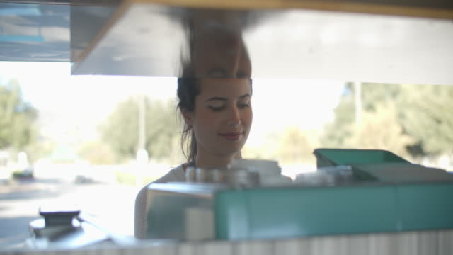 cu young woman working in a food truck - booth stock videos & royalty-free footage