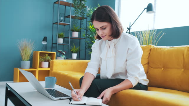 young woman working in a modern workplace. - employee engagement stock videos & royalty-free footage