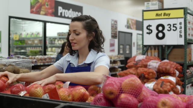 stockvideo's en b-roll-footage met young woman working in a warehouse supermarket - shelf