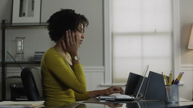 ms pan young woman working in office, using bluetooth device / orem, utah, usa - orem utah stock videos & royalty-free footage