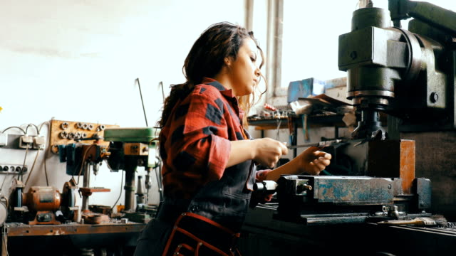 young woman working in production - craftsman stock videos and b-roll footage