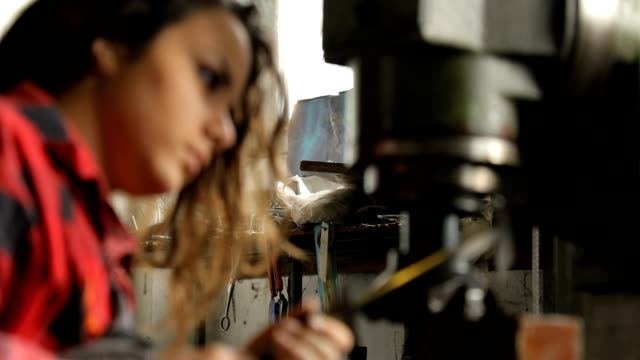 Young woman working in production