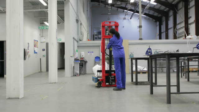 Young Woman Working in the Engineering Workshop