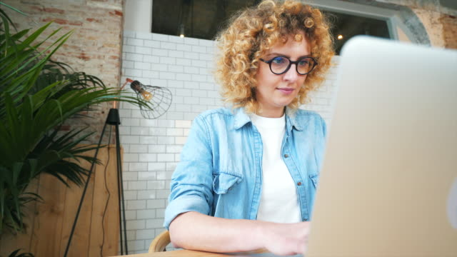 young woman working in the office. - curly stock videos & royalty-free footage