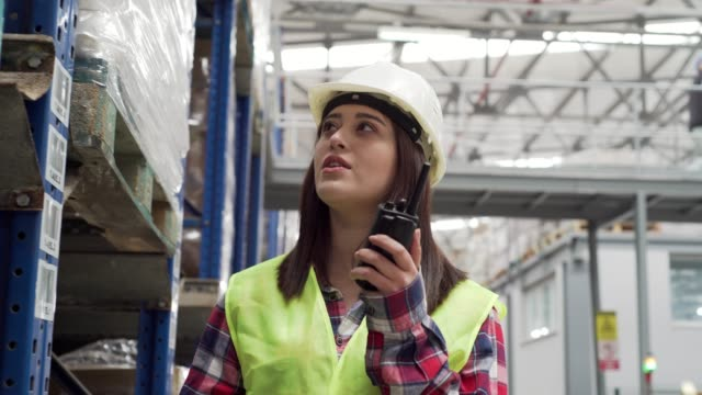 young woman working in the warehouse - radio stock videos & royalty-free footage