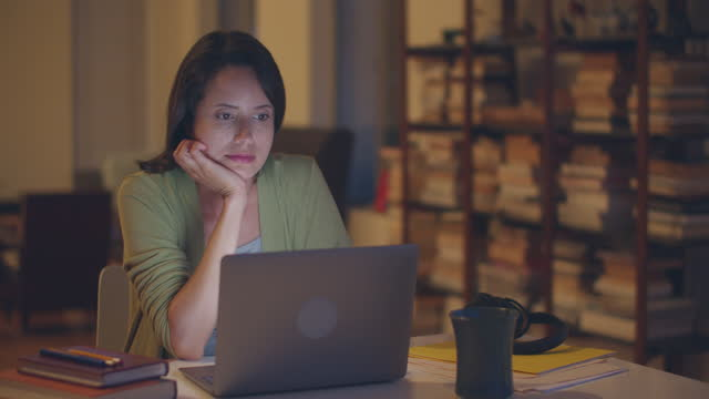 young woman working late at home - latin american and hispanic ethnicity stock videos & royalty-free footage
