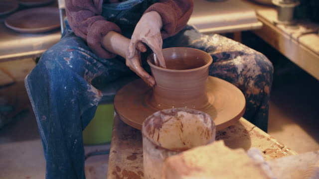 cu young woman working on a bowl in her ceramics studio - sculptor stock videos & royalty-free footage