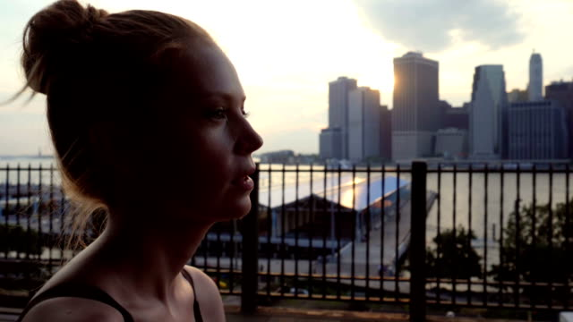 young woman working out against the new york city waterfront sunset - world trade centre manhattan stock videos and b-roll footage