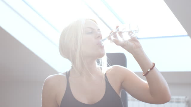 young woman working out and drink water - high key stock videos & royalty-free footage