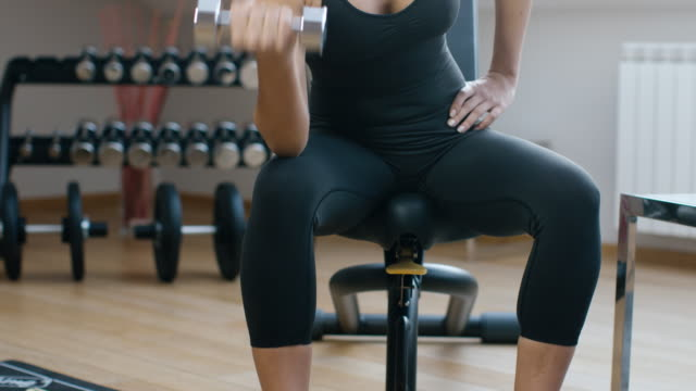 young woman working out, and drink water - high key stock videos & royalty-free footage