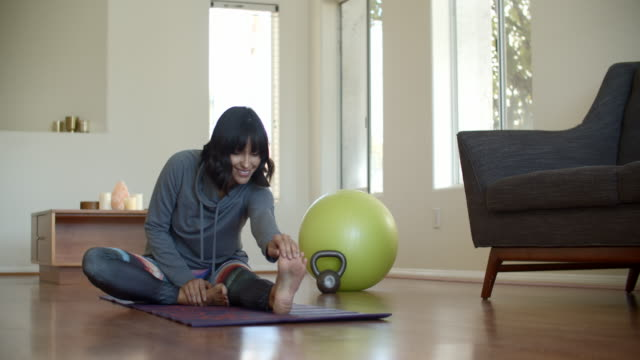 young woman working out at home - posture stock videos & royalty-free footage