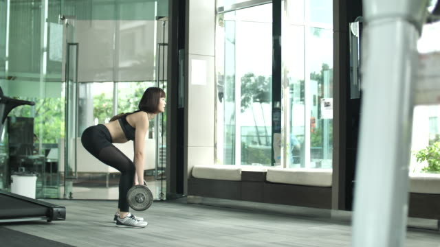 Young Woman working out with weight training