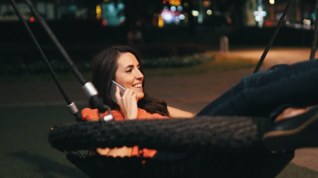 young woman working outdoor at night - swing stock videos & royalty-free footage