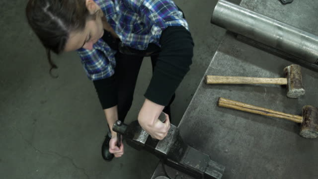 young woman working with a vise - genderblend stock videos & royalty-free footage