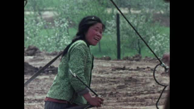young woman works hard pulling a construction cart; 1973 - maoism stock videos & royalty-free footage