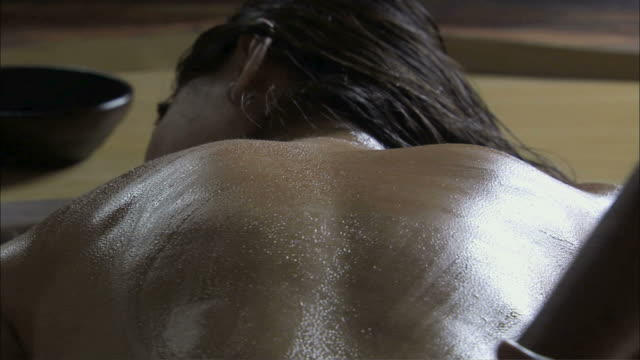 cu pan young woman's back massage with oil by hand / india - massage oil videos stock videos and b-roll footage
