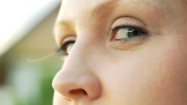 hd slow motion: young woman's eyes - green eyes stock videos and b-roll footage