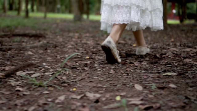 young woman's feet in grass - bride stock videos and b-roll footage