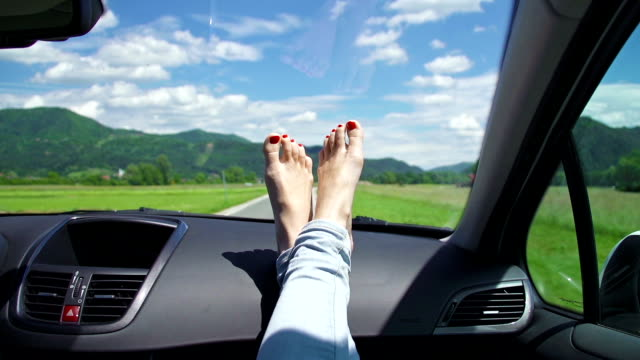 young woman's feet with polished nails on a dashboard - dashboard vehicle part stock videos and b-roll footage