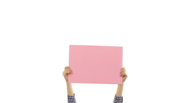 Young woman's hands holding a blank pink placard.