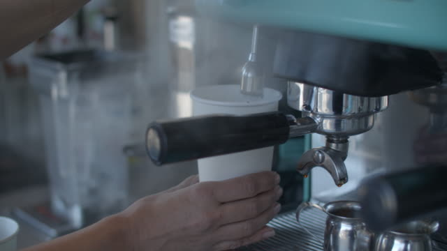 cu young woman's hands making espresso. - coffee cup stock videos & royalty-free footage