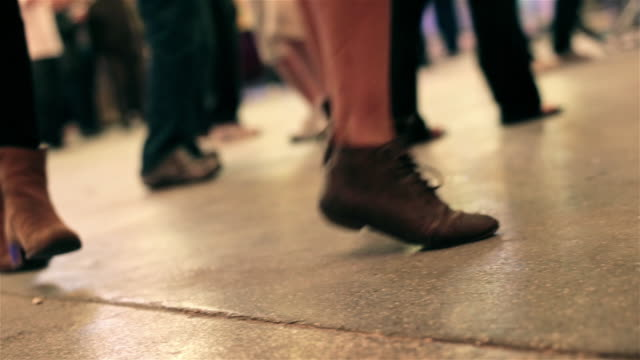 young womans kick and dance at outdoor concert in downtown Las Vegas