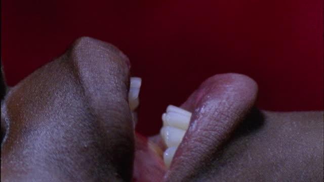 vidéos et rushes de ecu, young woman's lips - langue humaine