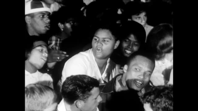 / young women and men singing 'keep your eyes on the prize' the night before the march on washington women and men singing the night before the march... - human rights stock videos and b-roll footage