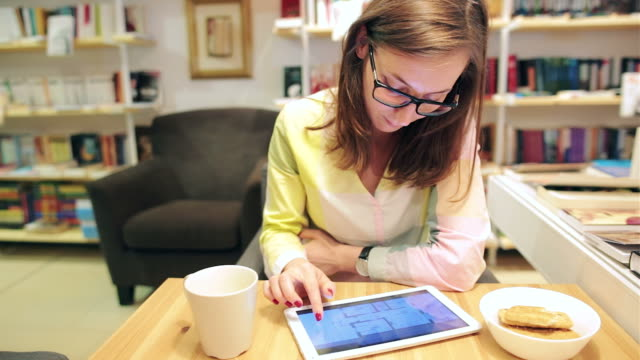 young women architect working on table with digital tablet. - architectural model stock videos and b-roll footage