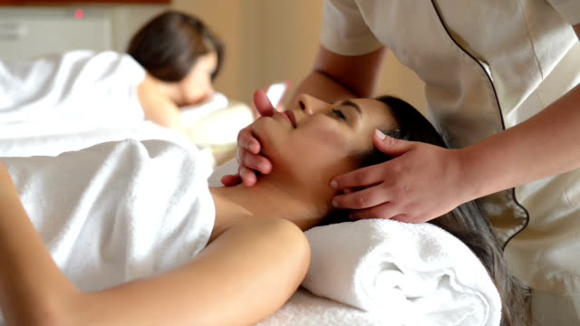 young women at spa treatment - facial massage stock videos and b-roll footage