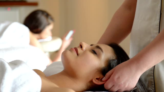 young women at spa treatment - spa treatment stock videos & royalty-free footage