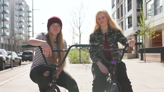 2 young women bmx riders looking to camera and smiling together - 20 29 years stock videos & royalty-free footage