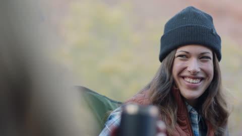 young women chat around campfire. - erwachsene person stock-videos und b-roll-filmmaterial