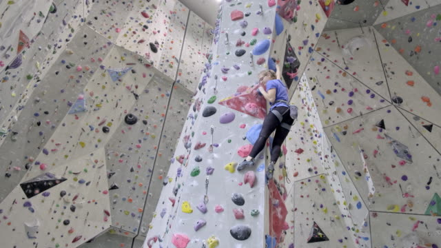 young women climbing on indoor climbing wall - climbing wall stock videos & royalty-free footage